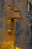 Old rusty door. Detail of the old rusty door stock photography