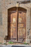Old Rusty Door. With Broken Wall Royalty Free Stock Photography