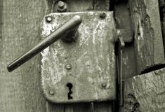 Old rusty door handle. Close-up of an ancient and rusty door (vintage Royalty Free Stock Image