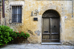 An old and rusty door. An old house and its rustic door Royalty Free Stock Photography