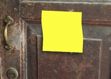 Old rusty door knob with yellow sticky notes. Old rusty door knob with a yellow sticky notes- provide message on the yellow paper Stock Image