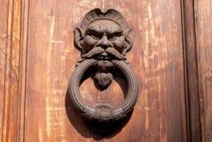 Old rusty door knocker Stock Photo