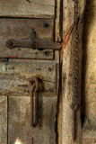 Old rusty door latch. Old stable door with latch on farm stable door, Worcestershire, England Stock Image