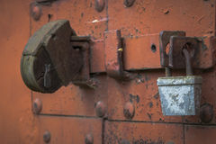 Old rusty door locks closeup. Two brown painted door lock rusty closeup Stock Images