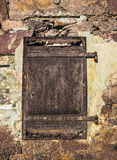 Old rusty door on a stone wall Royalty Free Stock Image
