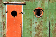 Old rusty door and window. On an old ship royalty free stock photo