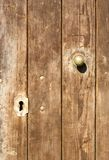 Old rusty doors. With keylock Stock Photos