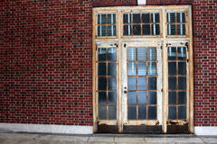 Old rusty doors in red brick wall Stock Photo