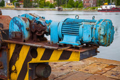 Old motor electric. Old rusty electric motor with a large port crane royalty free stock photography