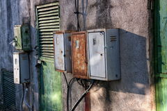 Old and rusty electricity boxes royalty free stock image