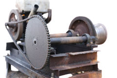 Old and rusty engin with chain Stock Photos