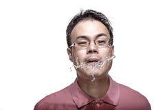 Man spitting water - high contrast. Facial expression : man spitting water - high contrast Stock Photos
