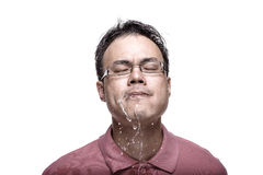 Man spitting water - high contrast. Facial expression : man spitting water - high contrast Royalty Free Stock Image