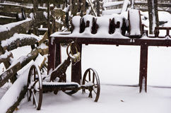 Old rusty farm equipment covered with snow at winter, mountain Kozomor. Serbia Stock Image
