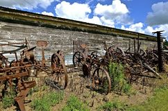 Old rusty farm equipment. Includes hay mowers and field cultivators Royalty Free Stock Image