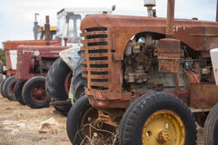 Old rusty farm tractor machinery Stock Image