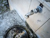 Old rusty faucet on concrete grey wall stock photos