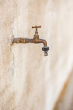 Old rusty faucet leaks Stock Photo