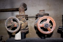 Old faucets. Old rusty faucets in the basement stock images