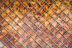 Old rusty fence  background. Old rusty fence with a lattice and steel sheet substrate background Royalty Free Stock Photography