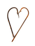 Old rusty fish hooks in form of heart Stock Images