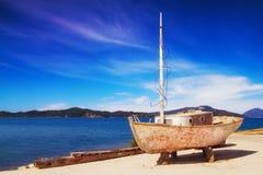 An old rusty fishing boat in the village of Petriti, Corfu Royalty Free Stock Photos