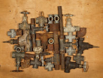 Old and rusty fittings and valves. Royalty Free Stock Photography