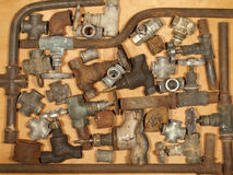 Old and rusty fittings and valves. Stock Photography