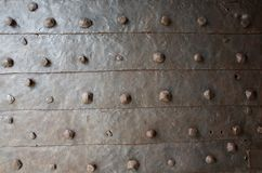 Old rusty forged metal with rivets texture royalty free stock photos