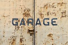 Old rusty garage doors. With text Garage Stock Image