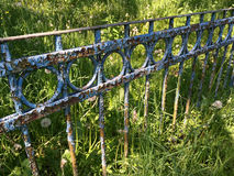 Old rusty garden fence with cracked blue paint Royalty Free Stock Images