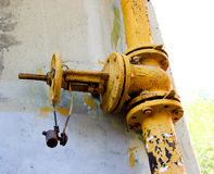 An old rusty gas control valve on the wall Royalty Free Stock Images