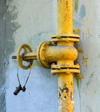 An old rusty gas control valve on the wall Royalty Free Stock Photography