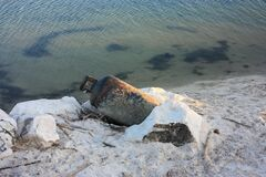 Free Old Rusty Gas Cylinder Abandoned To Pollute The White Sand Of The Sea Or River Beach Royalty Free Stock Image - 200233516