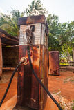 Old rusty gas pump. An old rusty and vintage abandoned gas pump Stock Image