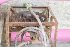 Old and rusty gas stove with supply gas pipes Royalty Free Stock Photography