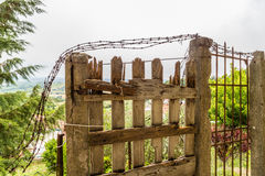 old rusty gate in ruins Stock Photo