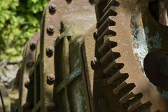 Old rusty gears. Closeup of old rusty gears with spiderweb Royalty Free Stock Images