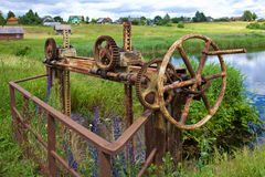 Old rusty gears and cogs. In nature Royalty Free Stock Image