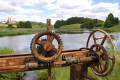 Old rusty gears and cogs. In nature Stock Photo
