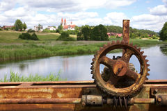 Old rusty gears and cogs. In nature Royalty Free Stock Photos