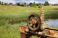 Old rusty gears and cogs. In nature Royalty Free Stock Photography