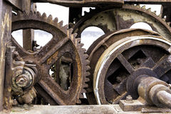 Old rusty gears for heavy industry as a machinery parts. Closeup Royalty Free Stock Photos