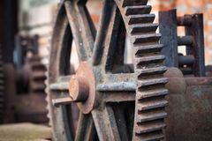 Old rusty gears, machinery parts. Photo of the old rusty gears, machinery parts Stock Images