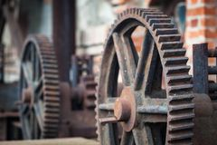Old rusty gears, machinery parts. Photo of the old rusty gears, machinery parts Royalty Free Stock Images