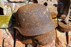 Old rusty German helmet of times of World War II royalty free stock images
