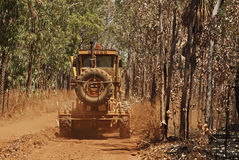 Old Rusty Grader Driving Outback Royalty Free Stock Images