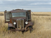 Old Rusty Grain Truck. An old rusty grain truck left to die a slow death in a North Dakota field Stock Images