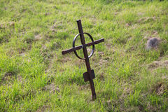 Old rusty grave cross on cemetery in ireland Stock Photo