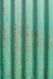 Old rusty green corrugated metal wall Royalty Free Stock Photos